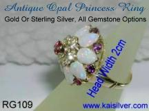 Custom gold princess ring with opal gem stone.