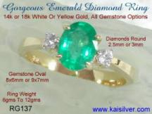 Gold engagement ring emerald diamond