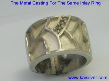Metal casting for inlay rings with gemstones